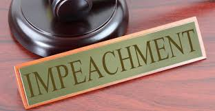 Gavel in upper left hand corner with name plaque featuring the word impeachment.