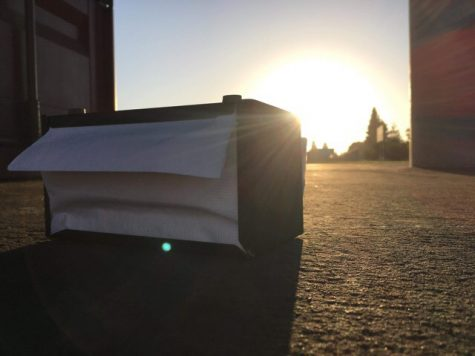 A lone napkin dispenser from the cafeteria lays between the two outer soccer fields at Fremont.